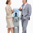 Business laughing next to the water dispenser — Stock Photo #10331771