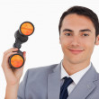 Close-up of a smiling businessman with binoculars — Stock Photo