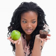 An apple and a bun are held up on the palms of a young womans ha — Stock Photo #10332076
