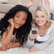 Two women are smiling at the camera and lying on the ground — Stock Photo