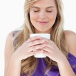 Young woman smelling her cup of coffee — Stock Photo #10334395