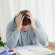 Distressed student in front of his books — Stock Photo