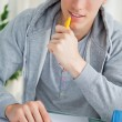 Handsome student using a calculator — Stock Photo