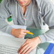 High-angle view of a student doing his homework while helping wi — Stock Photo #10334481
