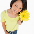 High-angle view of a Latino woman holding a flower — Stock Photo #10334679