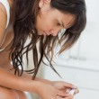 Young woman waiting for a pregnancy test result — Stock Photo