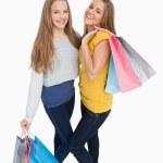 Two beautiful young women holding shopping bags — Stock Photo