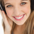 Close-up of a cute young blonde wearing headphones — Stock Photo #10335361