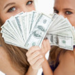 High-angle view of two young woman behind dollars — Stock Photo