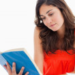 Royalty-Free Stock Photo: Student reading a blue book