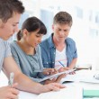 Side view of three students studying — Stock Photo