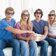 A group of friends watching a scary 3d movie — Stock Photo #10336932
