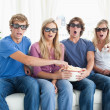 Stock Photo: A group of friends watching a scary 3d movie