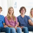 A group of sitting together on the couch — Stock Photo