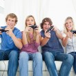 A group of friends playing video games together — Stockfoto #10336975