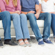 Half length shot of four pairs of feet — Stock Photo #10336990