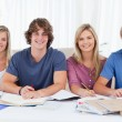 Four students looking at the camera - Foto Stock