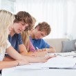 Students studying together at the table — Stock Photo #10337113