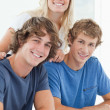 Stock Photo: Three smiling students as they look at the camera
