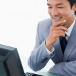 Portrait of a smiling manager using a computer — Stock Photo