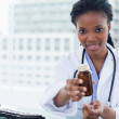 Young female doctor giving medication — Stock Photo #10338177