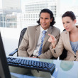 Business team using computer — Stock Photo #10338642