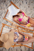 Overhead view of teenage girls sitting on deck chairs — Stock Photo