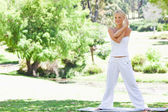 Woman doing her stretches in the park — Stock Photo