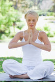 Relaxed woman in a yoga position — Foto Stock