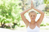 Relaxed woman in a yoga position in the park — Stock Photo