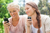 Friends with their cellphones — Stock Photo