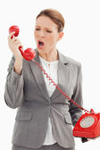 Businesswoman shouts down the phone — Stock Photo