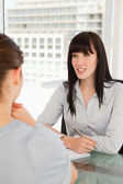 The smiling business woman chats to the other woman — Stock Photo