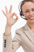 Approbation of a businesswoman with a headset — Stock Photo