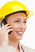 Close-up of a woman wearing safety helmet on the phone — Stock Photo