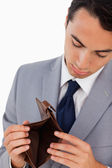 Man in a suit showing his empty wallet — Foto Stock