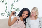 Two women pose from a photo — Stock Photo