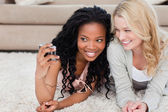 A woman is talking a picture of herself and her friend — Stock Photo