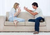A couple sitting on a couch are having an argument — Stock Photo