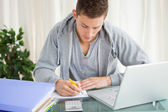 Student doing his homework — Stock Photo