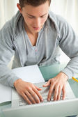 Close-up of a happy student doing homework — Stock Photo