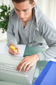 Student doing his homework with a netbook — Stock Photo
