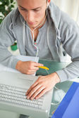 High-angle view of a student doing his homework while helping wi — Stock Photo