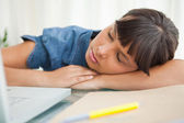 Female student sleeping on her desk — Stock Photo