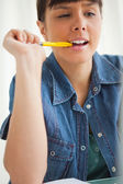 Student grimacing while doing her homework — Stock Photo