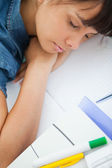 High-angle view of a female student sleeping — Stock Photo