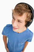 Fisheye view of a male student wearing headphones — Stock Photo