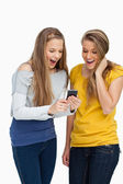 Two surprised students looking a cellphone screen — Stock Photo