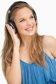 Close-up of a beautiful young woman wearing headphones — Stock Photo