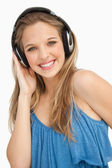 Portrait of a beautiful young woman wearing headphones — Stock Photo